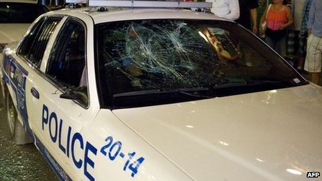 Police car damaged in protests, 9 June