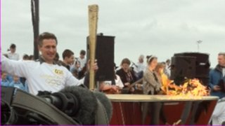 William Sichel lights the cauldron