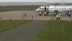The Olympic flame prepares to leave Kirkwall airport