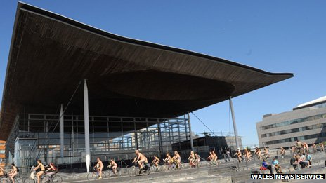 The riders alongside the Senedd building
