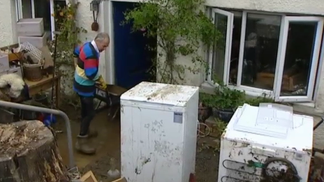 This home is being cleared out after it was hit by flooding