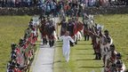 Torchbearer Matthew Cox and a Viking guard of honour