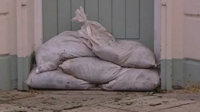 Sand bags protecting a house from flooding