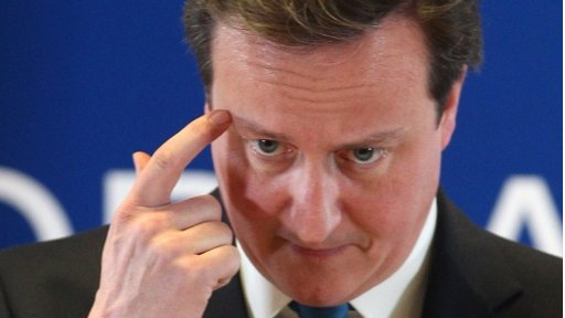 David Cameron seemly scratching or pointing to his head