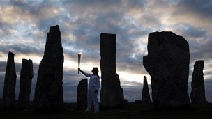 Olympian and Commonwealth gold medallist Kirsty Wade took the flame to the Callanish Standing Stones as the sun rose
