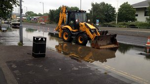 Penistone Road in Sheffield. JCB parked in flood water