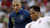 England's Joleon Lescott controls the ball in front of France's Karim Benzema