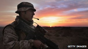 Silhouette of British soldier on patrol