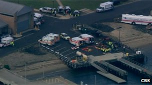 Aerial shot of ambulances waiting in Sandy Hook, NJ 11 June 2012