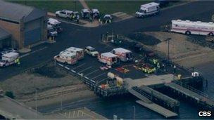 Aerial shot of ambulances waiting in Sandy Hook, NJ 11 June 2012