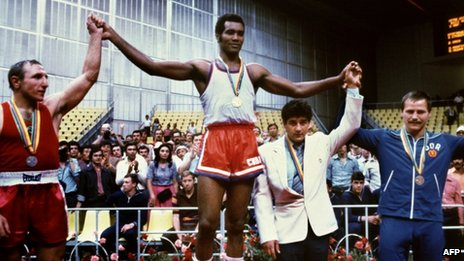 Cuban champion Teofilo Stevenson (centre- gold medal), Soviet Pyotr Zaev (left-silver medal) and German Democratic Republic's Jurgen Fanghanel (right - bronze medal) on the podium at the Moscow Olympics