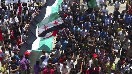 Demonstrators take part in a protest against Syria&#039;s President Bashar al-Assad in Sermeen, near the northern city of Idlib on 8 June 2012