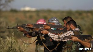 Free Syrian Army members fire at targets as they train on the outskirts of Idlib on 7 June 2012