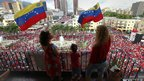 Supporters of Venezuela&#039;s President Hugo Chavez hold up flags 