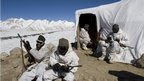 Indian soldiers are seen at one of the shelters by the glacier, with the Saltoro ridge in the background