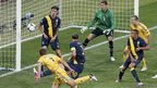 Ukraine&#039;s Andriy Shevchenko (left) scores his second goal against Sweden