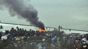 Burning structures at a village in Sittwe, the capital of Rakhine