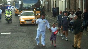 Ian Bishop walks with his daughter in Brechin