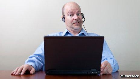 Man grimacing at computer screen