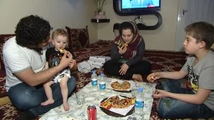 A family eating pizza