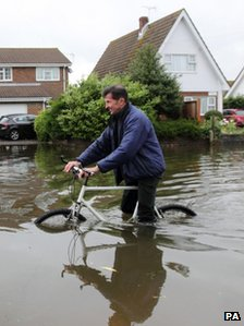 Man with bike in flood