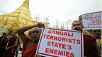 Rakhine Buddhist monks hold up an anti-Rohingya sign at a demonstration at the Shwedagon pagoda in Yangon after clashes broke out between Rakhine and Rohingya in northwest Burma.
