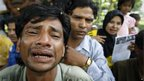A Rohingya protester cries as he holds a placard during a rally to call for an end to the ongoing unrest and violence in Burma's Rakhine state, in Kuala Lumpur, Malaysia