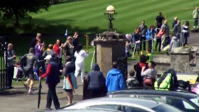 The Olympic torch is carried towards Scone Palace