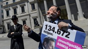 Activists in Madrid protest against the government of Prime Minister Mariano Rajoy