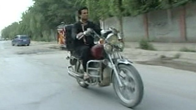 Pizza being delivered on a motorbike