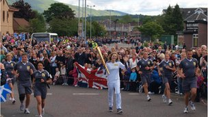 Kate Pearson takes her turn with the torch