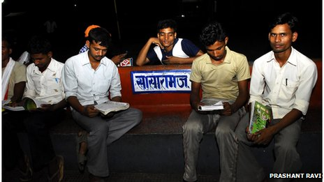 Men studying on the railway station in Sasaram
