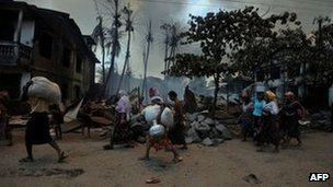 Muslim residents evacuating their houses amid ongoing violence in Burma&#039;s Rakhine state