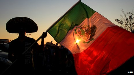 Mexican football fan waves flag outside stadium in Philadelphia before US-Mexico football match - August 2011
