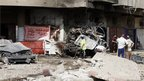 Wreckage of cars and damaged shop fronts in Karrada in Baghdad