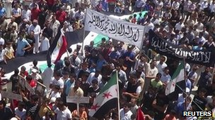 "Protest against  Bashar al-Assad in Sermeen near Idlib, June 8 2012. The banner reads: ""There is only one god and Muhammad is his prophet""."