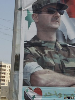 A picture of Syrian President Bashar al-Assad at one of the entrances of Homs city