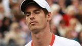 Andy Murray looks dejected as he is knocked out of Queens
