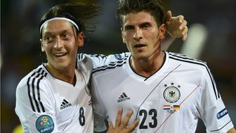 Mesut Ozil and Mario Gomez