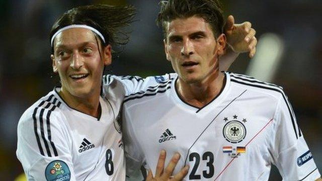 Mesut Ozil and Mario Gomez