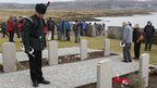 A wreath laying ceremony at the San Carlos cemetery in the Falklands