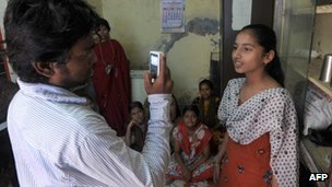 A Video Volunteer Dalit community correspondent interviewing a girl