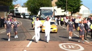 Kenneth Reid with the torch
