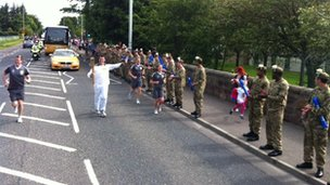 Royal Highland Fusiliers line the torch route