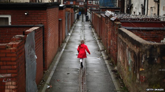 Girl playing in an alley