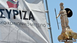 "The statue of the ancient goddess Athena, patron of Athens in the city""s, is seen near the Syriza radical left party"