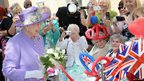 Queen Elizabeth II meets members of the public as she visits a new maternity ward at Lister Hospital in Stevenage