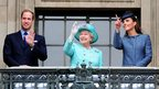 Queen Elizabeth II (C), Prince William (L) and Catherine, Duchess of Cambridge (R) wave from the balcony of Council House, in Nottingham, during a visit.