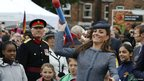 Catherine, Duchess of Cambridge throws a foam javelin as she joins in with a children's sports event during a visit to Vernon Park in Nottingham