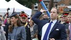 Prince William throws a foam javelin during the event